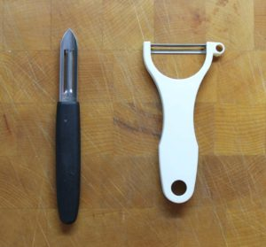 two examples of different styles of vegetable peelers