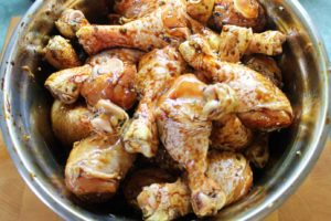 3 lbs chicken drumsticks marinating in a bowl