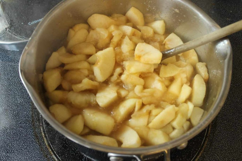 Apples cooking in a pot to make apple pie filling