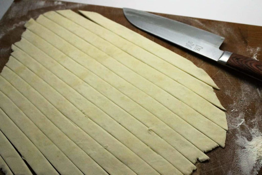 pie dough cut into strips to form a lattice top