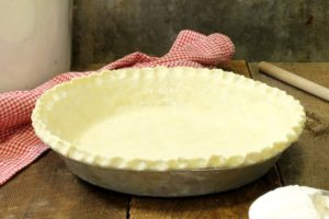 a homemade pie dough in a pie pan ready to use