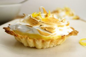 lemon meringue tart on a white plate
