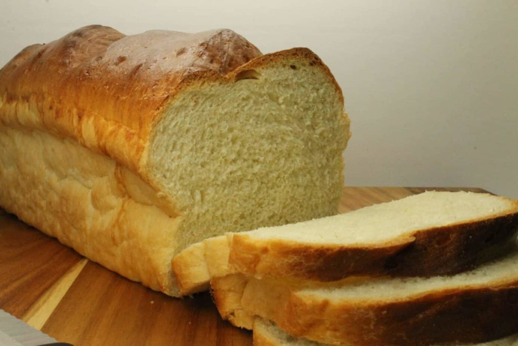 A freshly sliced loaf of homemade sandwich bread