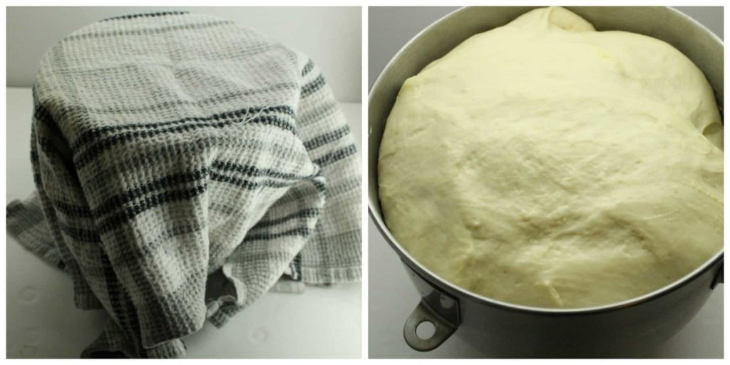 Bread dough proofing in a metal mixing bowl.
