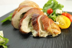 A savory stuffed chicken breast wrappen in Prosciutto bacon. Learn how to properly stuff chicken!
