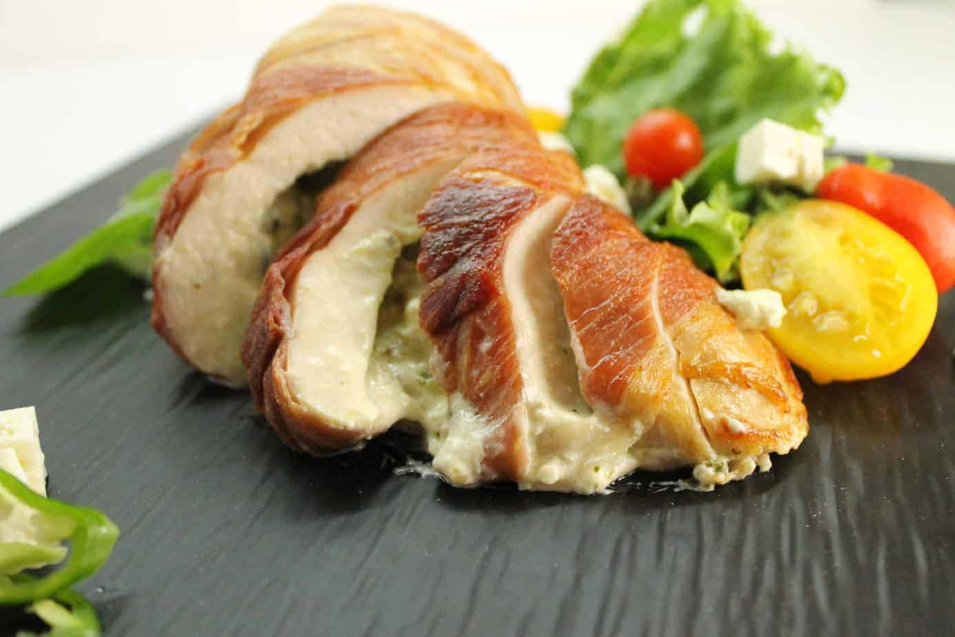 Savory stuffed chicken breasts wrapped in Prosciutto are a delicious and surprisingly easy meal to make.