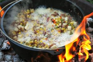 de-glazing a pot of corn chowder by adding beer to it