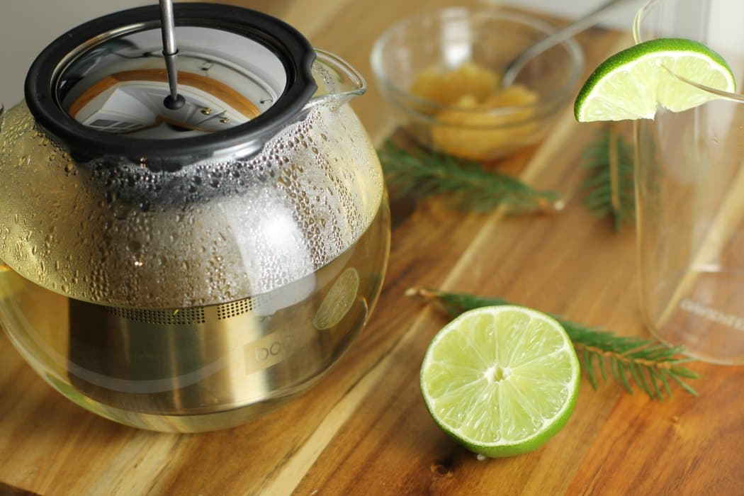 Let spruce tea steep for 10 to 15 minutes before adding the honey and lime for a delicious and healthy beverage.
