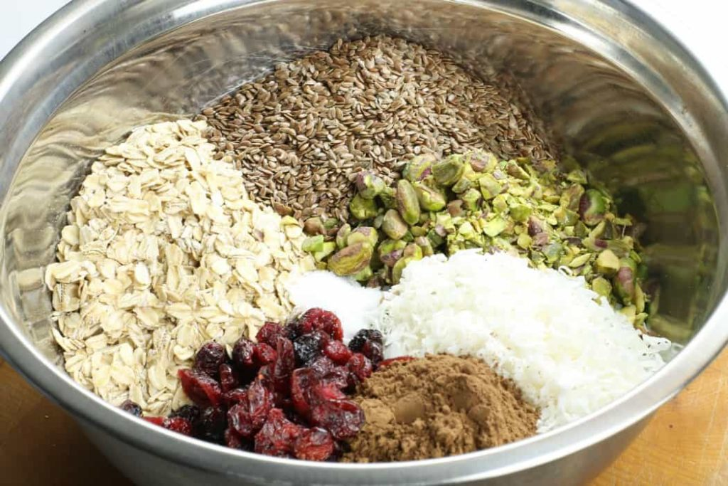 A simple mix of ingredients in a bowl for making homemade granola bars.