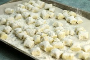 Freeze fresh gnocchi dumplings on a well floured tray to prevent them from sticking