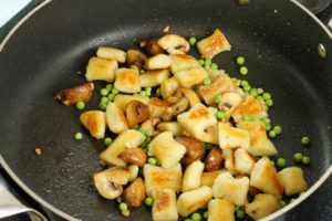 Pan fry the gnocchi until golden brown.