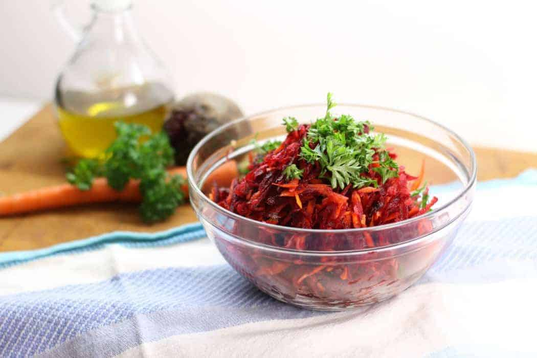 Using just a simple box grater, this healthy shredded beet salad with, carrots, apples, and walnuts is a great side to any meal. Clean eating and Paleo friendly