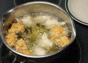 Fry the Bajan Fish Cakes in oil, either in a pot over medium heat or a portable deep fryer!