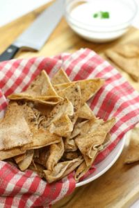 The perfect after school snack, oven baked pita chips with hummus and veg!
