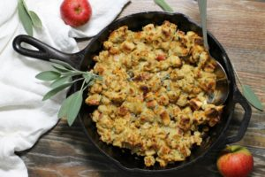 Easy to make, moist, and full of flavor, this apple and sage stuffing cooked in a cast iron skillet will become your new favorite dressing recipe! #skillet #stuffing #dressing #thanksgiving #apple