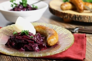 german braised red cabbage served on a fancy gold rimmed glass plate