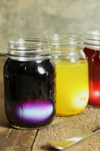 hard boiled eggs in jars of homemade easter egg dye