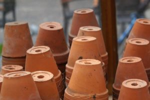 clay flower pots stacked in rows