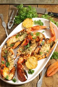 a large platter of whole grilled lobsters. The perfect gourmet BBQ meal or entree served at New Years