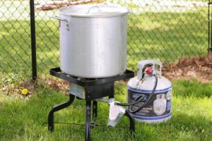 A propane lobster cooker and pot in the garden