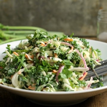 A simple kale slaw ready o be served at a family bbq or potluck