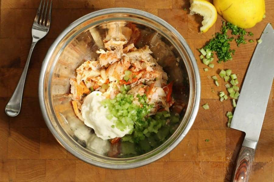 lobster roll ingredients in a metal bowl prior to mixing