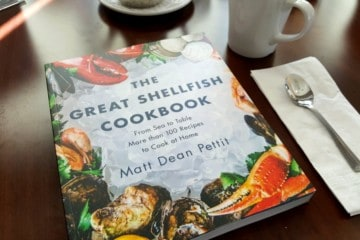 A copy of the great shellfish cookbook on a table