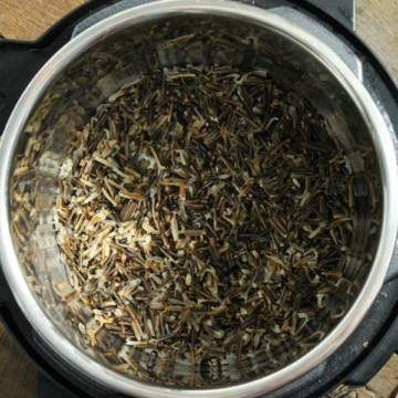 a bowl of wild rice cooked in an instant pot
