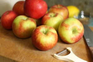 freshly picked honeycrisp apples on a wooden cutting board