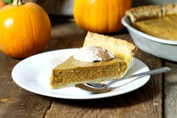 close up shot of a slice of dairy free pumpkin pie