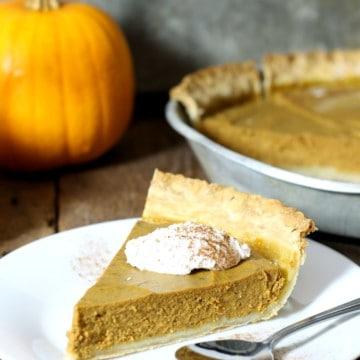 close up shot of a slice of dairy free pumpkin pie