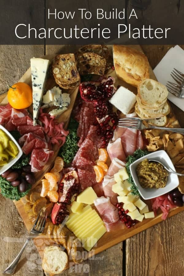 an overhead shot of a rustic themed charcuterie platter