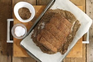 an uncooked sirloin tip roast heavily coated with a coffee rub spice mixture to marinate overnight