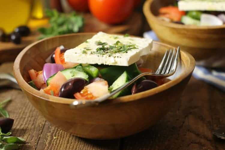 Horiatiki or traditional Greek salad in a wooden bowl
