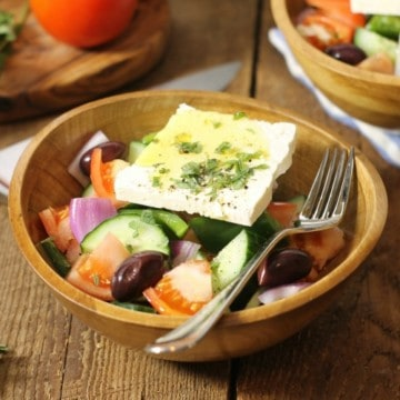 traditional greek salad known in greece as horiatiki, served in a rustic wooden bowl