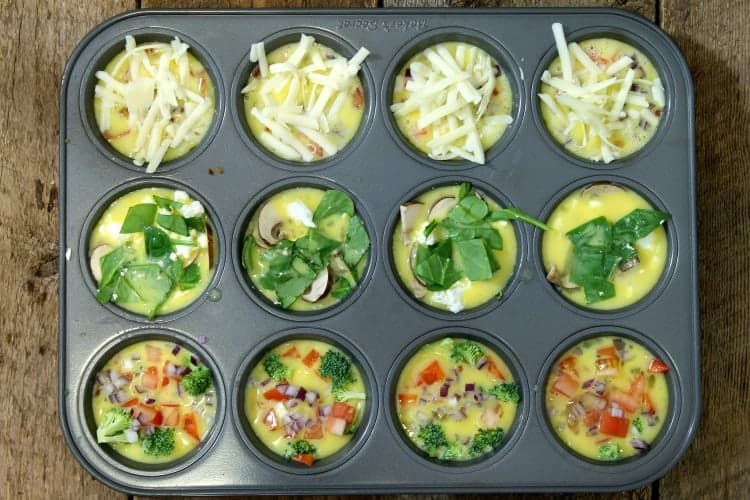 un cooked breakfast egg muffins assembled in a 12 cup muffin tin