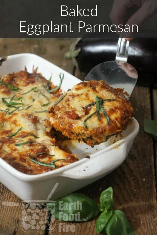 baked eggplant parmesan in a casserole dish on a barn board table