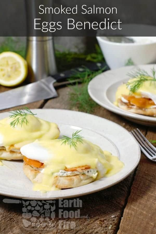 smoked salmon eggs benedict garnishe with dill on a rustic breakfast setting