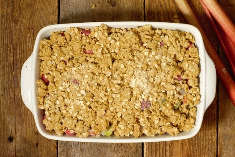 unbaked strawberry rhubarb crumble in a stone casserole dish
