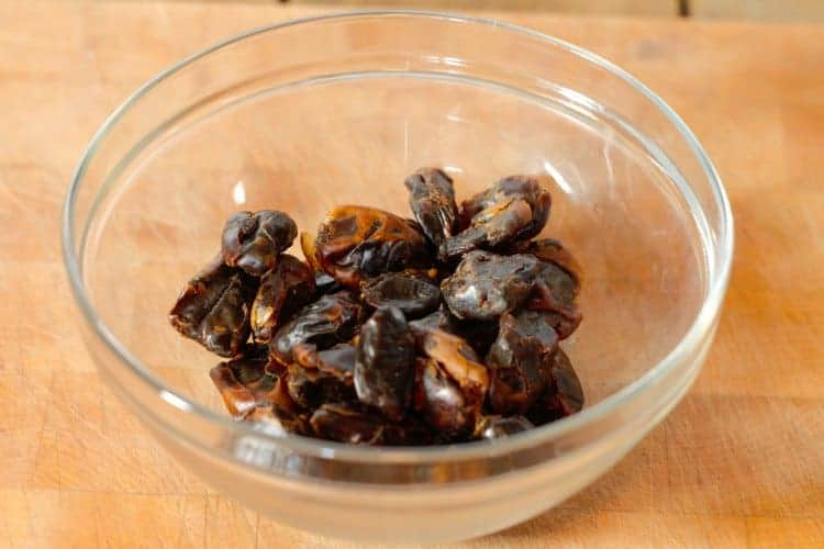 dried dates in a glass bowl