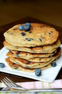 blueberry sourdough pancakes in a stack