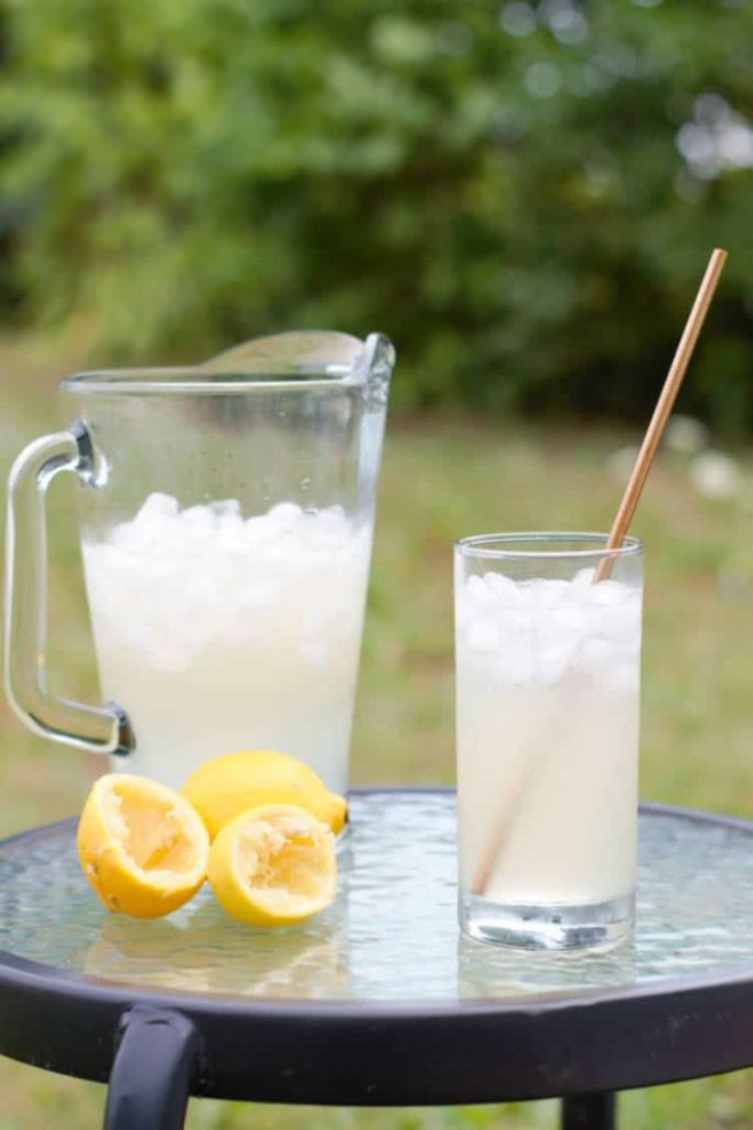 real old fashioned lemonade in a glass on a table outside