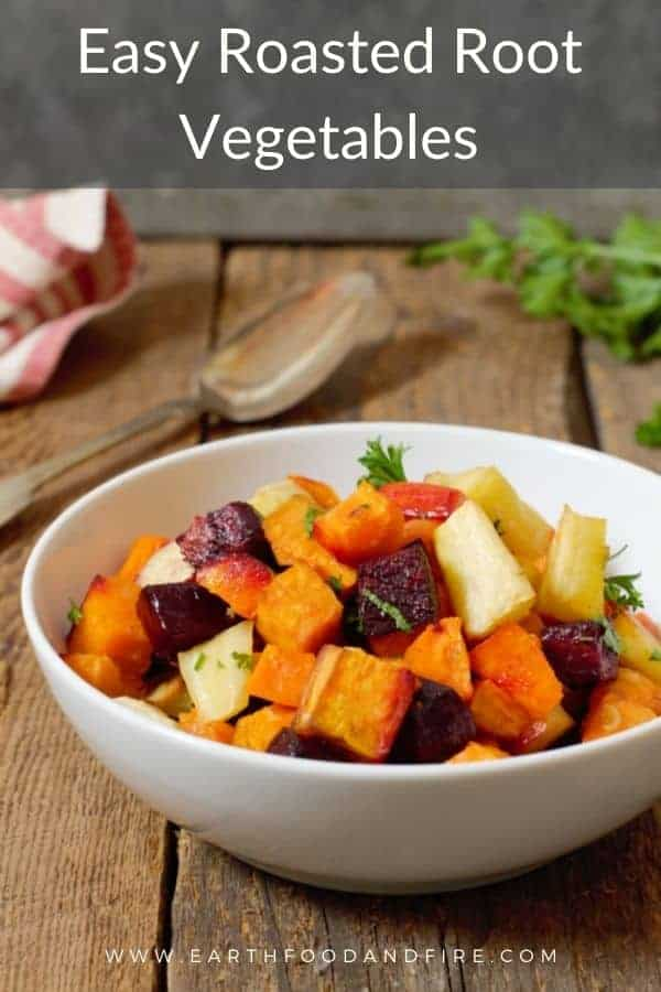 oven roasted root vegetables in a white bowl with Pinterest text overlay