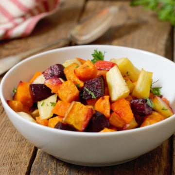 oven roasted root vegetable medley in a white porcelain bowl