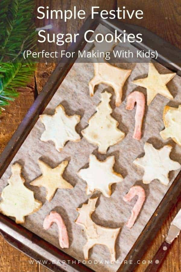 festive pastel colored sugar cookies on a baking sheet