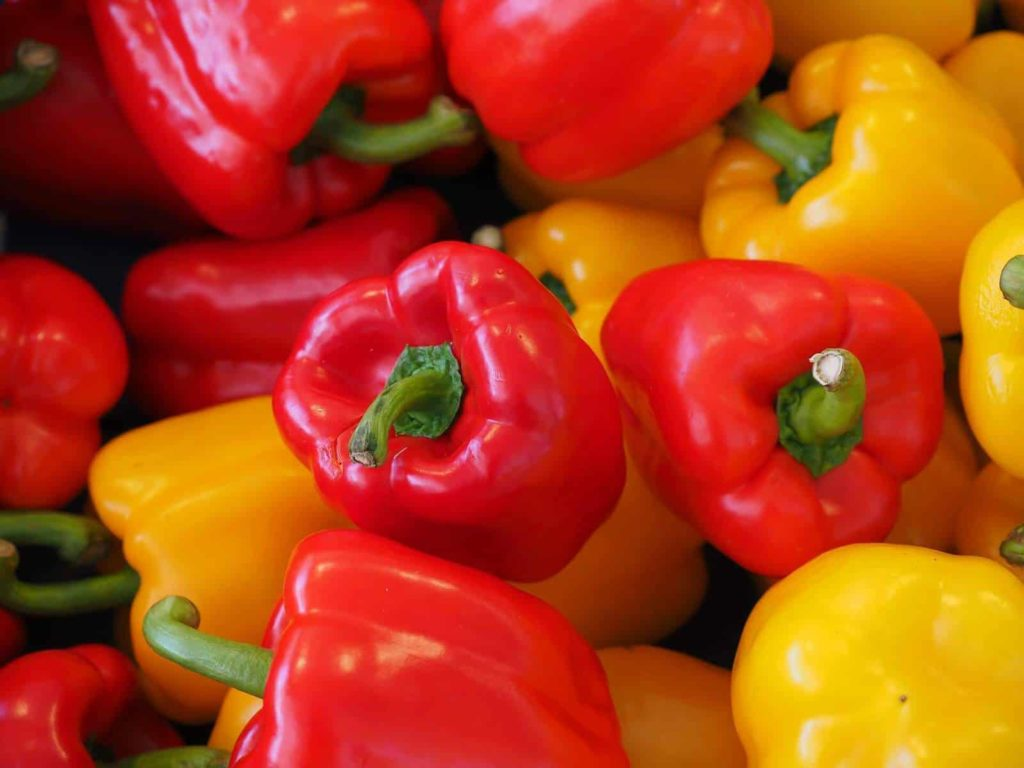 close up of red and yellow bell peppers